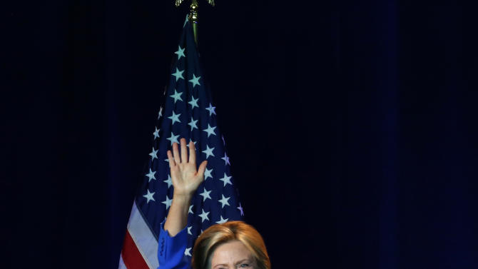Democratic presidential candidate, Hillary Rodham Clinton waves as she leaves the stage after she speaking at the summer meeting of the Democratic National Committee, Friday, Aug. 28, 2015, in Minneapolis. (AP Photo/Jim Mone)