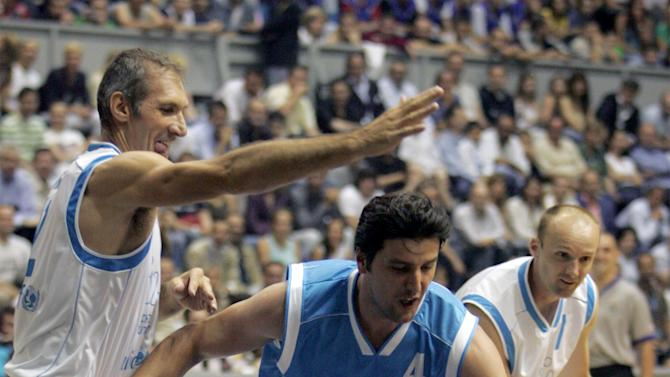 FILE - In this July 3, 2005 file photo Predrag Danilovic, center, challenges for the ball with Antonello Riva, left during an basketball match, in Belgrade, Serbia. Danilovic, former basketball star who played for NBA's Miami Heat and Dallas Mavericks, has been seriously injured in a bar fight. Police say Danilovic was stabbed during a brawl early Saturday in a cafe in a residential part of the capital, Belgrade. Doctors say Danilovic underwent an operation after suffering serious injuries to his abdomen, head and arms. (AP Photo/Darko Vojinovic, file)