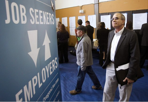 FILE - In this April 24, 2012, file photo, job seeker Alan Shull attends a job fair in Portland, Ore. The Labor Department said Friday, May 4, 2012, that the economy added just 115,000 jobs in April.