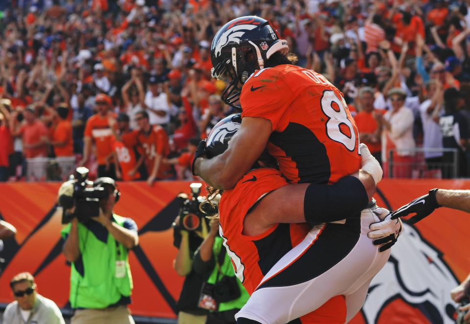 Denver Broncos wide receiver Eric Decker (87) celebrates with guard Zane Beadles (68) after scoring a touchdown against the Oakland Raiders during the third quarter of an NFL football game, Sunday, Sept. 30, 2012, in Denver. (AP Photo/David Zalubowski)