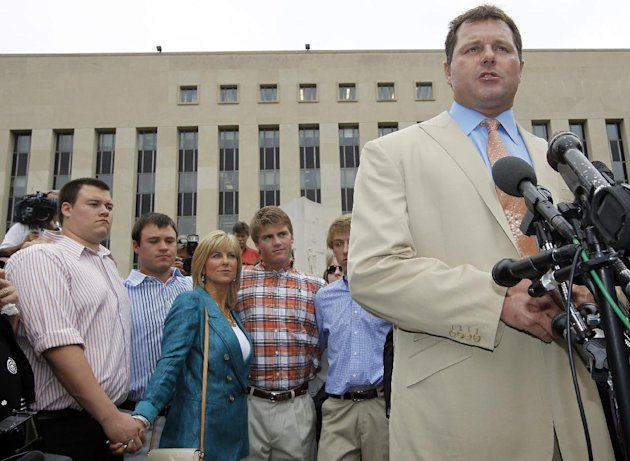 Former Major League Baseball pitcher Roger Clemens, right, speaks outside the federal court in Washington, Monday, June 18, 2012, after his acquittal on charges of lying to Congress in 2008 when he denied ever using performance-enhancing drugs. With Clemens are his wife and sons, from left, Kory, Koby, Debbie, Kacy and Kody Clemens. (AP Photo/Pablo Martinez Monsivais)