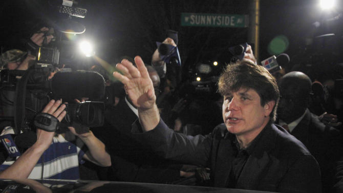 FILE - In this March 15, 2012 file photo, former Illinois Gov. Rod Blagojevich departs his Chicago home for Littleton, Colo., to begin his 14-year prison sentence on corruption charges. On the one-year anniversary that he began serving the prison sentence, Blagojevich's wife, Patti, says the former Illinois governor is teaching Civil War history and learning to play the guitar. (AP Photo/Charles Rex Arbogast, File)