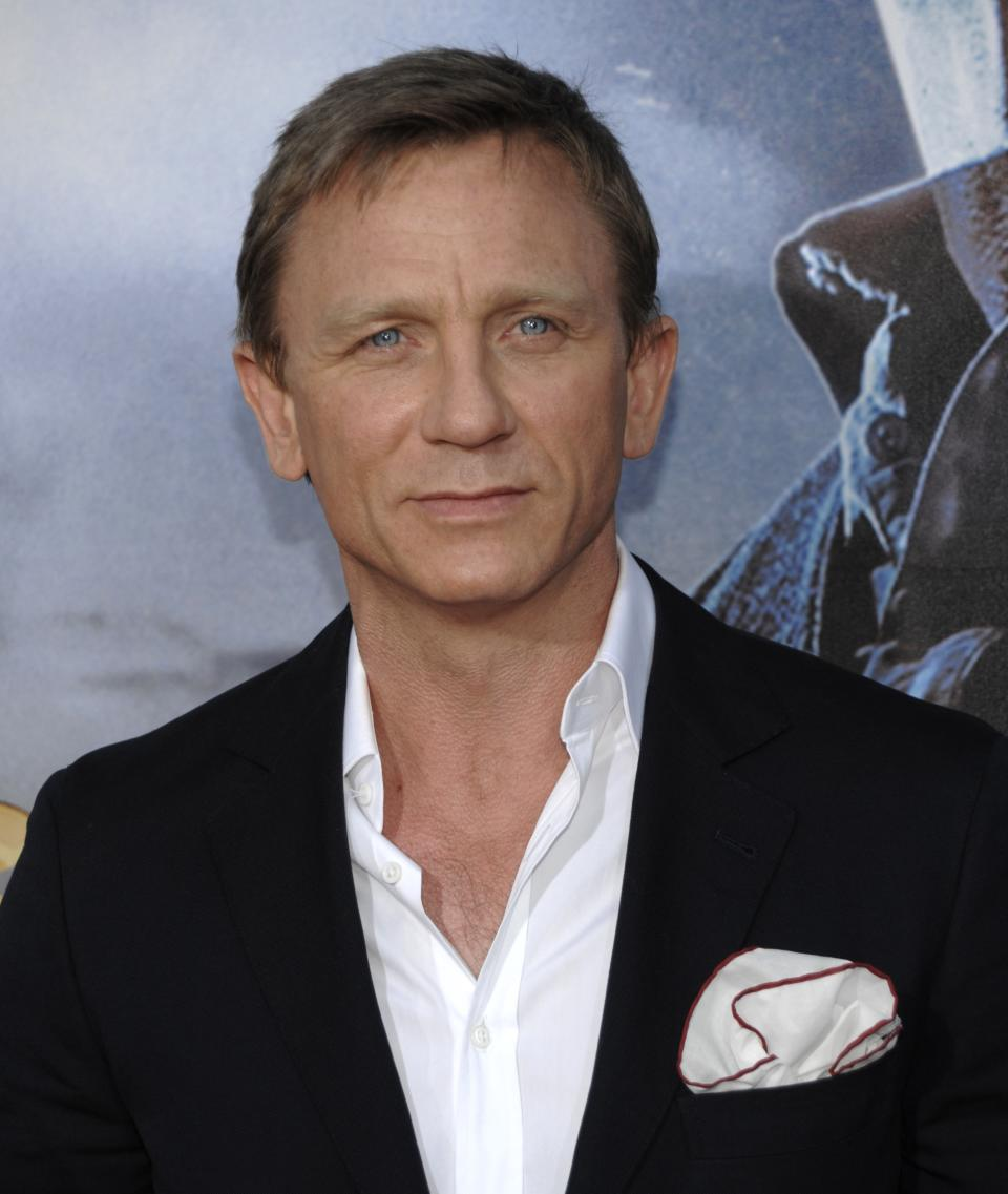 "Actor Daniel Craig arrives at the premiere of the feature film ""Cowboys and Aliens"" at Comic Con in San Diego, Calif. on Saturday, July 23, 2011. (AP Photo/Dan Steinberg)"