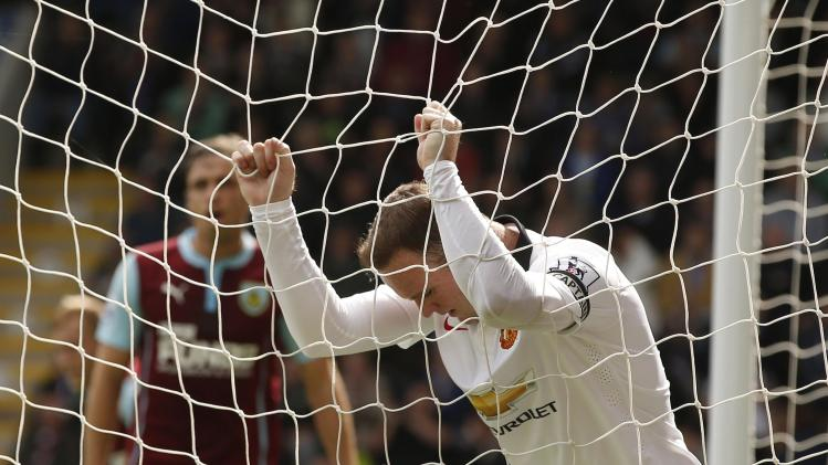 Manchester United's Rooney reacts after a missed opportunity during their English Premier League soccer match against Burnley at Turf Moor in Burnley