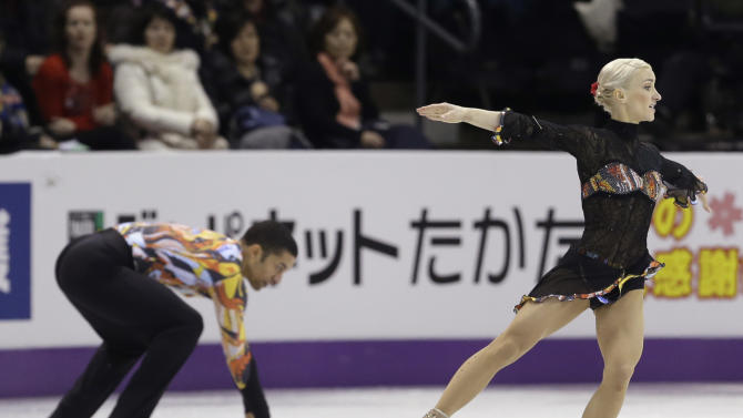 Aliona Savchenko, right, performs as Robin Szolkowy, of Germany, gets up after falling on the ice during the pairs free program at the World Figure Skating Championships Friday, March 15, 2013, in London, Ontario. (AP Photo/Darron Cummings)