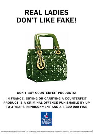 """This image made available by the anti-counterfeiting group, Comite Colbert, shows a poster edited by French Customs and distributed by the Comite Colbert in Paris Wednesday May 30, 2012, to fight against the sale of counterfeit goods in the world. An association of 75 French luxury brands has launched a campaign against knockoff designer products, warning people in seven European countries of the high costs of fake goods to the industry — and potentially to buyers and sellers. The anti-counterfeiting group, Comite Colbert, put up posters Wednesday in Paris featuring photos of fake phones, shades, watches and horse skin handbags next to printed warnings of potential high fines and even jail time. One reads: """"A bet on the wrong horse can be very expensive."""" Another advises, """"Buy a fake Cartier, get a genuine criminal record.""""  (AP Photo, HO)"""