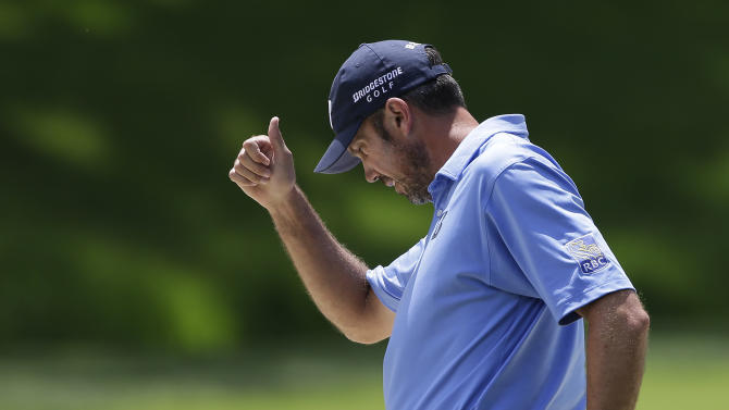 Matt Kuchar reacts after hitting out of the bunker on the second hole during the final round of the Memorial golf tournament on Sunday, June 2, 2013, in Dublin, Ohio. (AP Photo/Darron Cummings)