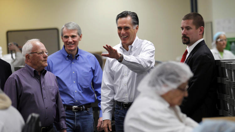Republican presidential candidate, former Massachusetts Gov. Mitt Romney, tours Meridian Bioscience makes a campaign stop in Cincinnati, Ohio, Monday, Feb. 20, 2012. At left is Meridian founder and CEO Bill Motto, second from left is Sen. Rob Portman, R- Ohio. (AP Photo/Gerald Herbert)