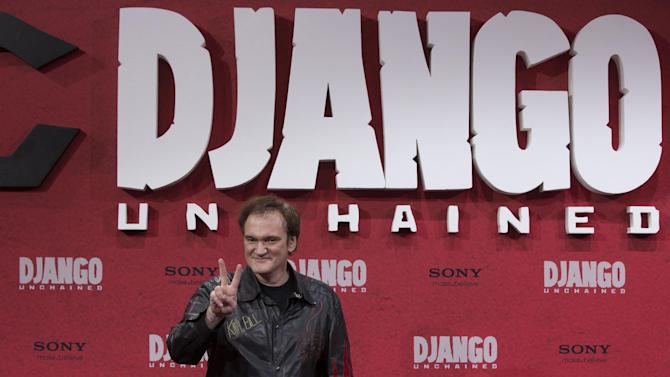 "FILE - In this Jan. 8, 2013 photo, U.S. director Quentin Tarantino arrives for the German premiere of the movie ""Django Unchained"" in Berlin, Germany. Chinese theaters pulled ""Django Unchained"" at the last minute, despite widespread reports that Tarantino had bowed to censors' demands by dampening the film's violence. China said only that the film's screening had been halted for ""technical reasons"" without elaborating what that meant. (AP Photo/Gero Breloe, File)"