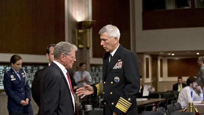 Sen. James Inhofe, R-Okla., the ranking Republican on the Senate Armed Services Committee, left, confers with Adm. Samuel Locklear, commander of U.S. Pacific Command, on Capitol Hill in Washington, Tuesday, April 9, 2014, prior to the committee's hearing focusing on the Korean peninsula during a review of defense authorization requests for fiscal year 2014.  (AP Photo/J. Scott Applewhite)