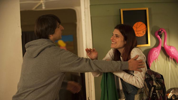 "This publicity photo released by Roadside Attractions shows, Demetri Martin, left, and Lake Bell, in a scene from the film ""In a World...,"" a comedy about a struggling voice coach. Written and directed by Bell, who also stars in the film, it won the Sundance 2013 Waldo Salt Screenwriting Award for the script. Real voice-over artists, the men and women who've spent years invisibly announcing the latest Taco Bell temptation, the promise of Firestone tires or upcoming Lifetime programs, who've seen the film (which expands to more than 30 locations Aug. 16, 2013) say it's great to watch their profession on screen. (AP Photo/Roadside Attractions, Bonnie Osborne)"