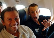 US Lance Armstrong (R) and his team director Johan Bruyneel, pictured after the ninth stage of the 92nd Tour de France cycling race between Gerardmer and Mulhouse, in 2005. Tour de France organizers admitted that they were against re-attributing Armstrong&#39;s seven wins as the sport&#39;s doping crisis claimed a new victim, Bruyneel, one of the disgraced American&#39;s closest allies