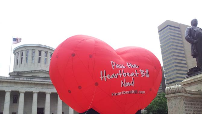 FILE - In this June 5, 2012 file photo, a large balloon in support of the Heartbeat Bill flies outside the Statehouse in Columbus, Ohio. The bill that would have imposed some of the nation's most stringent abortion restrictions failed in an Ohio House floor vote, but may re-surface when the new General Assembly takes over in 2015. (AP Photo/Ann Sanner, File)