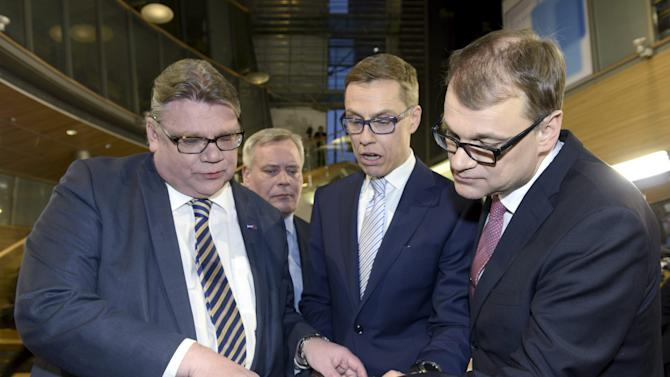 Chairmen (L to R) Timo Soini of the Finns Party, Antti Rinne of the Social Democratic Party, Alexander Stubb of the National Coalition and Juha Sipilä of the Centre Party attend parliamentary elections media reception in Helsinki, Sunday April 19, 2015. Finland voted Sunday to determine which coalition could lift the country out of a three-year recession, with the opposition Center Party in an early lead over the ruling conservatives whose leader, Prime Minister Alexander Stubb, acknowledged his government was slow to enact economic reforms.   (AP Photo / LEHTIKUVA / Heikki Saukkomaa / Lehtikuva via AP)  FINLAND OUT  NO  SALES