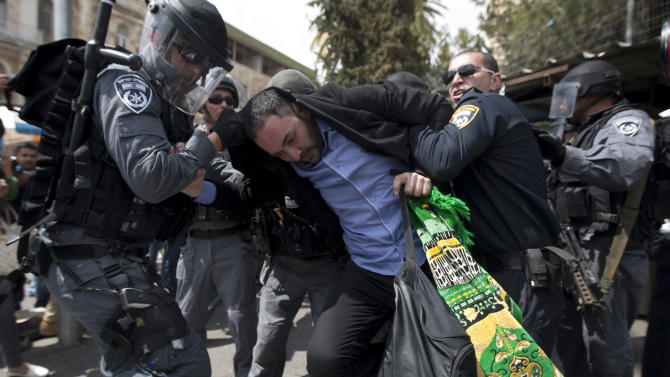 """Israeli police officers detain a Palestinian man outside Damascus Gate in Jerusalem's Old City, Friday, March 30, 2012. Israeli security forces in riot gear Friday confronted Palestinian demonstrators, anticipating possible clashes along Israel's frontiers on """"Land Day"""". The """"Land Day"""" rallies are an annual event marked by Israeli Arabs and Palestinians in the West Bank and Gaza who protest what they say are discriminatory Israeli land policies. (AP Photo/Sebastian Scheiner)"""