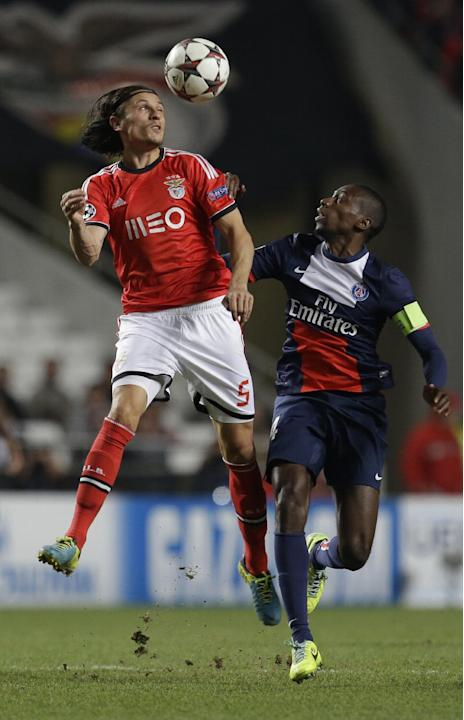 Benfica's Ljubomir Fejsa, left out jumps PSG's Blaise Matuidi during a Group C Champions League soccer match between Benfica and PSG at the Luz stadium in Lisbon, Tuesday Dec. 10, 2013