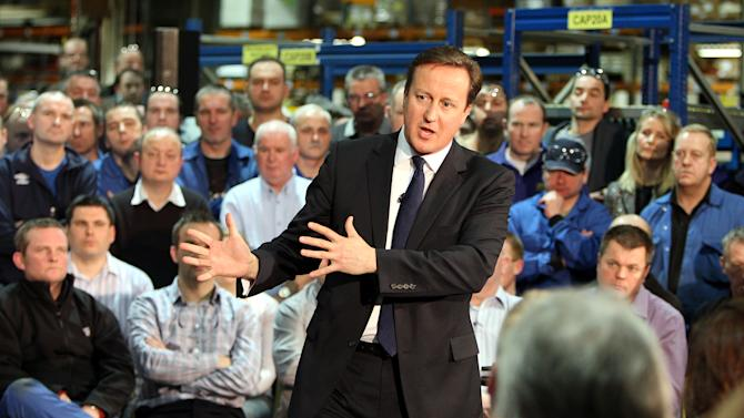 Britain's Prime Minister David Cameron answers questions at a factory, near Portadown, Northern Ireland Tuesday Nov. 20, 2012, where he confirmed that next year's G8 summit of world leaders will be held  at a luxury resort in Co Fermanagh, Northern Ireland. (AP Photo/Paul Faith/Pool)