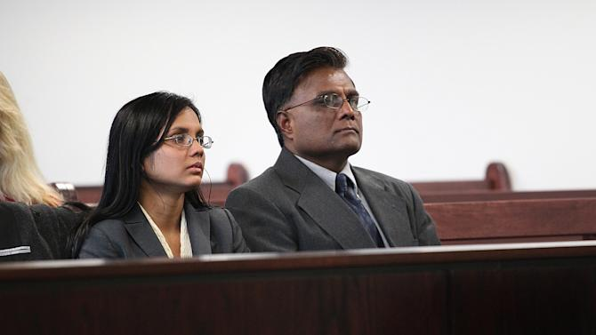Former state lab chemist Annie Dookhan, left, sits in Middlesex Superior Court for arraignment with her father, Rasheed Khan, on Wednesday, Jan. 9, 2013, in Woburn, Mass. Dookhan pleaded not guilty to three counts of obstruction of justice.  She is charged in connection with altering drug evidence during the testing process and obstructing justice. Prosecutors allege Dookhan fabricated test results and tampered with drug evidence while testing substances in criminal cases.  (AP Photo/The Boston Globe, Suzanne Kreiter, Pool)