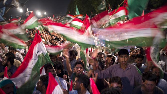 """Supporters of Pakistan's fiery Muslim cleric Tahir-ul-Qadri attend a sit-in protest while camping outside the parliament building in Islamabad, Pakistan, Wednesday, Sept. 17, 2014. Anti-government demonstrators led by opposition politicians Imran Khan and Qadri converged on the capital in mid-August, demanding Prime Minister Nawaz Sharif's ouster over alleged fraud in last year's election. Sharif said that """"up until now, we have tolerated all this and acted with decency and patience,  otherwise it's no hard task for us to clear the way and clear the streets.""""(AP Photo/B.K. Bangash)"""