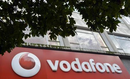 Vodafone branding is seen outside a retail store in London