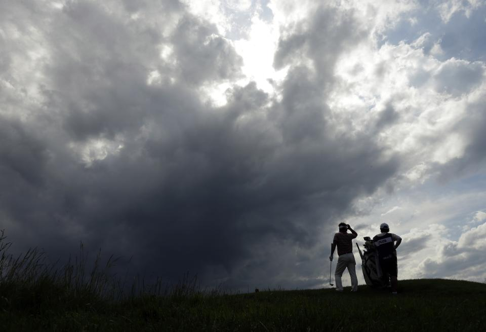 Hiroyuki Fujita, of Japan, lines up a shot on the ninth hole during the first round of the U.S. Open golf tournament at Merion Golf Club, Thursday, June 13, 2013, in Ardmore, Pa. (AP Photo/Charlie Riedel)