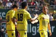 Dortmund's Lucas Barrios (C) celebrates with teammates after scoring a goal during their German first division Bundesliga match against Kaiserslautern, in Kaiserslautern, on April 28. Dortmund will be waving goodbye to Barrios who has signed a deal with Chinese club Guangzhou for next season