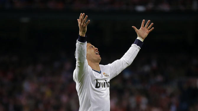 Real Madrid's Cristiano Ronaldo from Portugal reacts during the Copa del Rey final soccer match against Atletico de Madrid at the Santiago Bernabeu stadium in Madrid, Spain, Friday, May 17, 2013. (AP Photo/Daniel Ochoa de Olza)