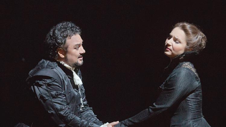 "In this Feb. 14, 2013 photo provided by the Metropolitan Opera, Ramón Vargas plays Don Carlo and Barbara Frittoli is Elisabeth de Valois during a dress rehearsal of ""Don Carlo"" at the Metropolitan Opera in New York. (AP Photo/Metropolitan Opera, Ken Howard)"