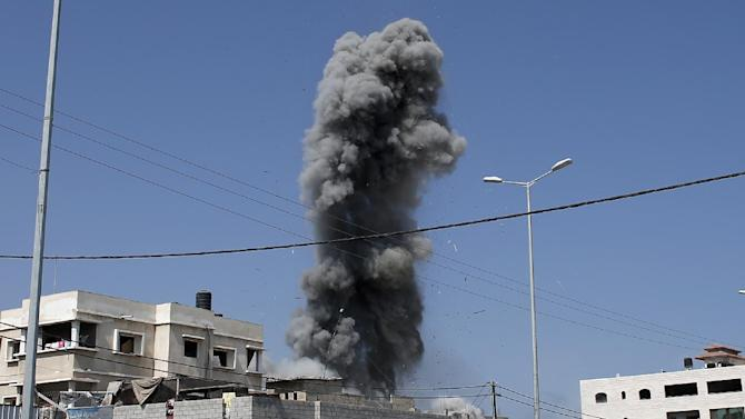 Smoke rises following an Israeli air strike on a Palestinian home in Gaza City on August 23, 2014