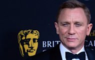 Actor Daniel Craig poses on arrival for BAFTA's 2012 Britannia Awards on November 7 in Beverly Hills, California. Craig wanted to get out of the role of James Bond from his first appearance as the famed British spy, he said in an interview published as the latest 007 movie was released in the US