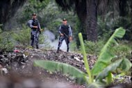 This file photo shows 'Cobras' elite police unit personnel standing guard in a plantation northeast of Tegucigalpa, in 2011. Gunmen on Saturday killed a lawyer who defended landless peasants in a region of northern Honduras that has been the scene of deadly land disputes, according to a farmers' association.
