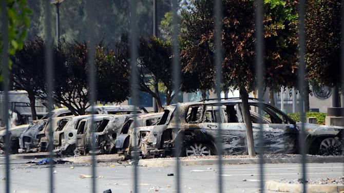 View of several dozen burned cars in the parking lot of the U.S. Embassy, a day after several thousand demonstrators angry over a film that insults the Prophet Muhammad stormed the compound, Tunis, Tunisia, Saturday, Sept. 15, 2012. Tunisia's governing moderate Islamist party condemned an attack on the U.S. Embassy in Tunis and the neighboring American school, saying Saturday that such violence threatens the country's progress toward democracy after decades of dictatorship. (AP Photo/Hassene Dridi)