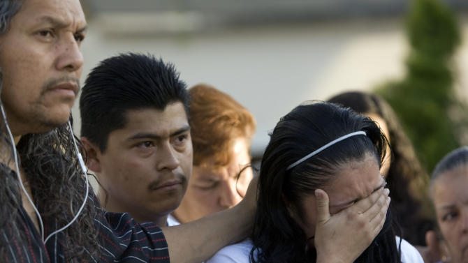 Johana Portillo-Lopez, daughter of Ricardo Portillo, who passed away after injuries he sustained after an assault by a soccer player at a soccer game he was refereeing on April 27, is comforted by Antonio Lopez, left, brother-in-law of Ricardo, as she speaks about her father's death during a press conference in Salt Lake City on Sunday, May 5, 2013. (AP Photo/The Salt Lake Tribune, Kim Raff)