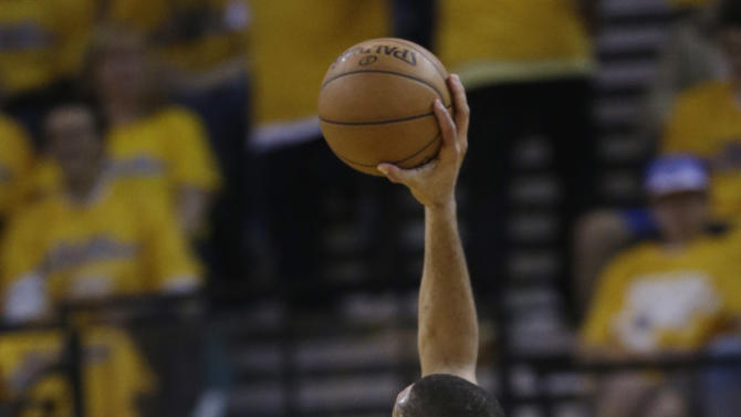 San Antonio Spurs' Tim Duncan, right, shoots over Golden State Warriors' Carl Landry during the first half of Game 3 of a Western Conference semifinal NBA basketball playoff series in Oakland, Calif., Friday, May 10, 2013. (AP Photo/Marcio Jose Sanchez)