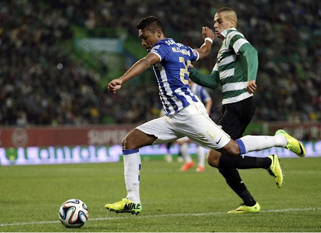 Porto's Alex Sandro, from Brazil, left, controls the ball past Sporting's Slimani during their Portuguese league soccer match Sunday, March 16, 2014, at Sporting's Alvalade stadium in Lisb