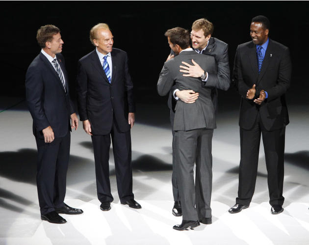 Famous Dallas sports figures Troy Aikman, Roger Staubach, Dirk Nowitzki, and Rolando Blackman congratulate Mike Modano during a jersey retirement ceremony before the NHL hockey game against the Minnes