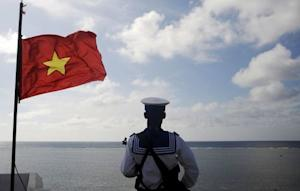 File photo of a Vietnamese naval soldier standing guard…