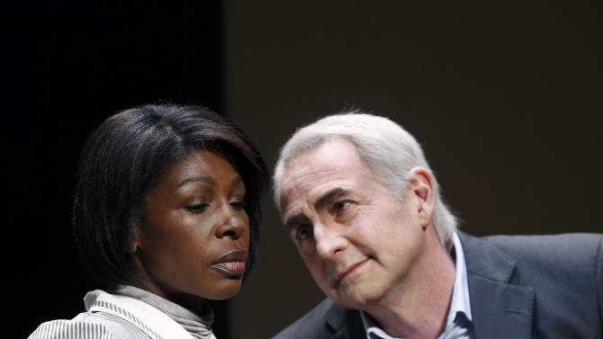 "FILE - In this Nov.15, 2012 file photo, French actor Eric Debrosse acting as former International Monetary Fund leader Dominique Strauss-Kahn, right, and actress Jelle Saminnadin acting as Nafissatou Diallo, the hotel housekeeper, who accused Dominique Strauss-Kahn of sexually assaulting her, pose during a photo opportunity as they perform in a play ""Suite 2806"" in a Paris theatre. One-time French presidential hopeful Dominique Strauss Kahn has been to hell and back since he was charged, then acquitted in New York of  making a hotel maid perform a sexual act in 2011. Now DSK will be treading the boards, in a salacious new play that recounts knock for knock what might have happened in the now infamous suite of the Manhattan Sofitel hotel. (AP Photo/Christophe Ena, File)"