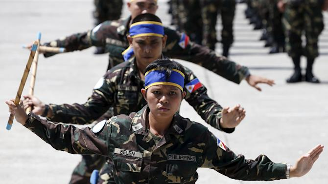Armed Forces of the Philippines personnel deploying to the United Nations peacekeeping mission in Haiti, demonstrate their local martial arts skills, during a sending-off ceremony at the Villamor air base in Pasay