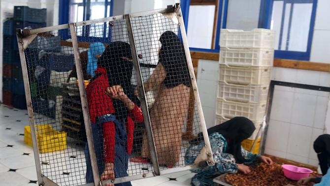 Girls work at the 'al-Gawhara factory', one of the biggest factories in Siwa for packaging dates