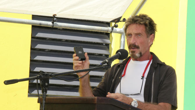 Software founder McAfee denies killing neighbor