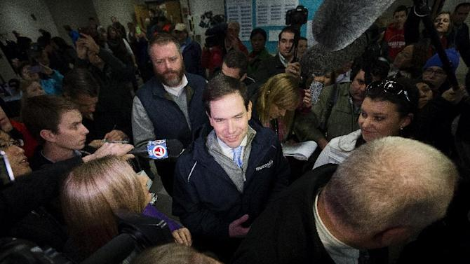 Republican presidential candidate, Sen. Marco Rubio, R-Fla. speaks to the media during a visit to a polling site at Bedford High School, Tuesday, Feb. 9, 2016, in Bedford, N.H. (AP Photo/John Minchillo)
