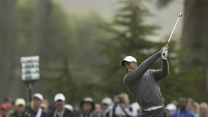 Tiger Woods hits a shot on the 11th hole during the first round of the U.S. Open Championship golf tournament Thursday, June 14, 2012, at The Olympic Club in San Francisco. (AP Photo/Charlie Riedel)