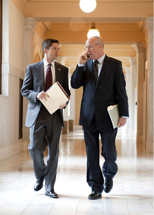 "Topher Grace as Jim Wilkinson and William Hurt as Henry Paulson in ""Too Big to Fail."""