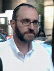 FILE- In this Aug. 24, 2011 file photo, Menachem Youlus leaves federal court in New York after appearing on mail and wire fraud charges. Youlus, a Jewish charity co-founder who claimed he traveled the world as a &quot;Jewish Indiana Jones&quot; to rescue Torahs, has pleaded guilty to fraud charges on Thursday, Feb. 2, 2012 in New York. (AP Photo/Larry Neumeister, File)