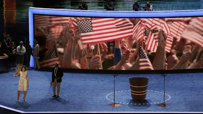 First Lady Michelle Obama waves to volunteers during a sound check for the Democratic National Convention in Charlotte, N.C., on Monday, Sept. 3, 2012. (AP Photo/Lynne Sladky)