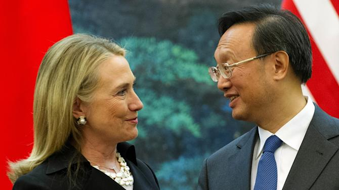 U.S. Secretary of State Hillary Rodham Clinton, left, speaks with Chinese Foreign Minister Yang Jiechi during a joint press conference at the Great Hall of the People in Beijing, China Wednesday, Sept. 5, 2012. (AP Photo/Jim Watson, Pool)