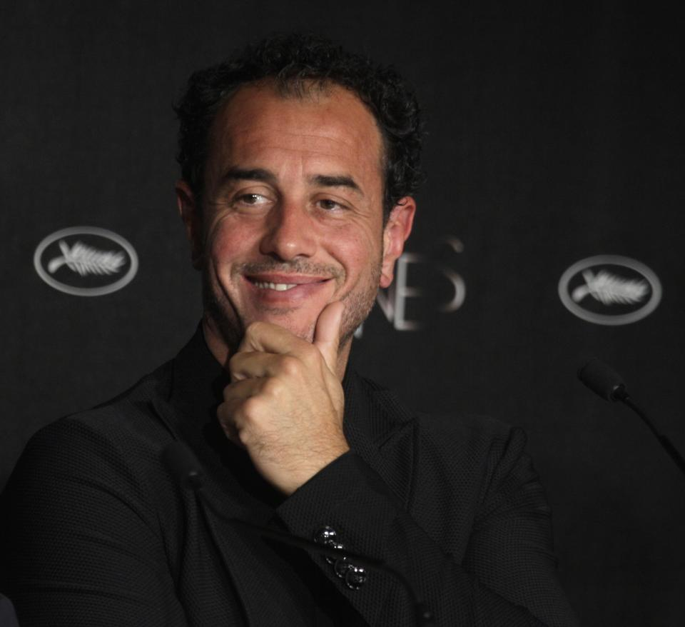Director Matteo Garrone smiles during a press conference for Reality at the 65th international film festival, in Cannes, southern France, Friday, May 18, 2012. (AP Photo/Virginia Mayo)