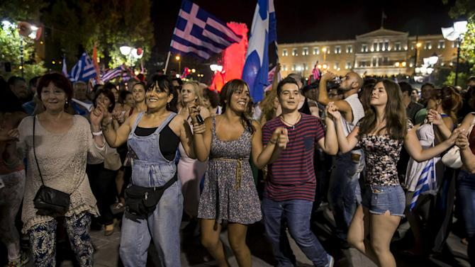 """""""No"""" supporters celebrate referendum results on a street in central in Athens"""