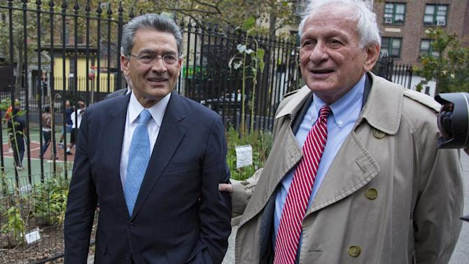 Former Goldman Sachs and Procter & Gamble Co. board member Rajat Gupta, left, arrives outside federal court in New York Wednesday, Oct. 24, 2012. Gupta is to be sentenced after being found guilty insider trading by passing secrets between March 2007 and January 2009 to a billionaire hedge fund founder who used the information to make millions of dollars. At right is Gupta's attorney Gary Naftalis. (AP Photo/Craig Ruttle)
